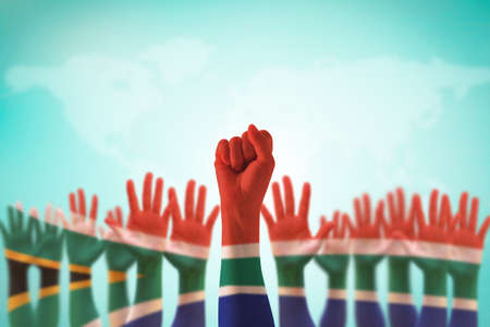 South Africa national flag on leader's fist hands for human rights, leadership, reconciliation concept