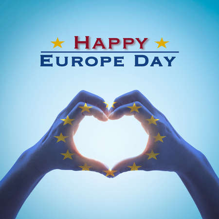 Happy Europe day  with European Union EU flag on people hands in heart love shape