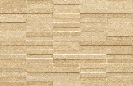 Modern polished granite tile wall pattern texture background in natural yellow cream beige color