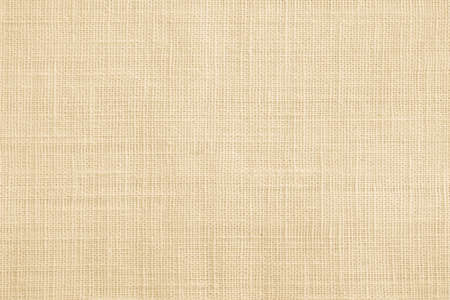 Jute hessian sackcloth canvas sack cloth woven texture pattern background  in yellow beige cream brown color