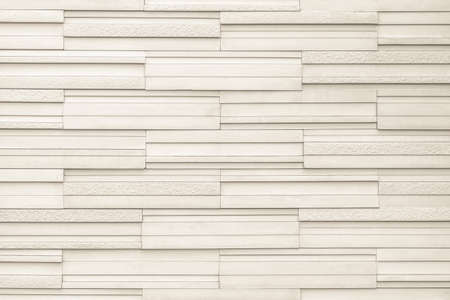 Granite tiled wall detailed pattern texture background in natural light beige brown