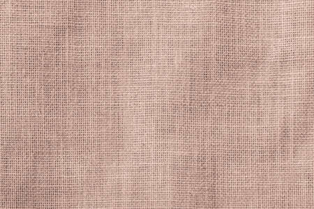 Hessian sackcloth woven texture pattern background in red brown color