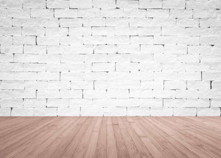 Brick wall painted in white with wooden floor textured background in natural red brown