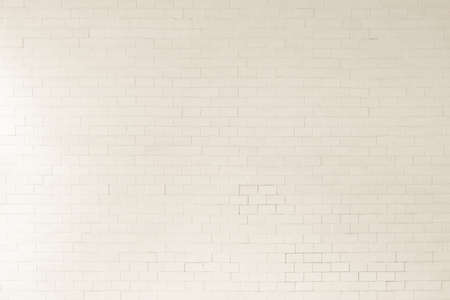 Brick wall tile texture background painted in antique sepia white