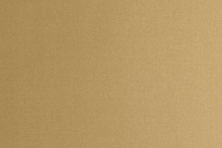 Fine authentic silk fabric texture pattern background in shiny light bright yellow gold brown color tone