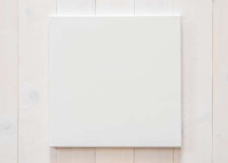White blank canvas mockup square size on white wood wall for arts painting and photo hanging interior decoration Zdjęcie Seryjne