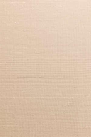 Silk cotton linen blended fabrics background in light orange cream beige sepia color
