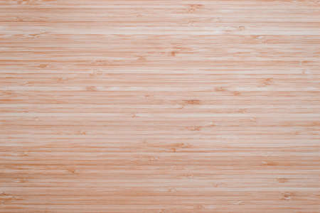 Bamboo wood texture background in natural light red brown color