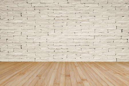 Grunge brick wall painted in light cream beige with wooden floor in yellow brown for interior backgrounds