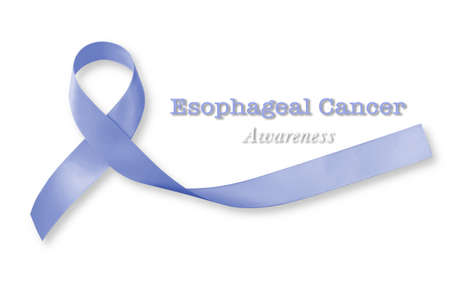 Esophageal cancer awareness Periwinkle color ribbon on human hand with aged wood background: