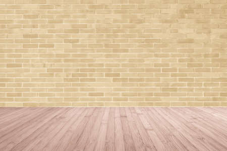 Light yellow brown brick wall with wooden floor in red brown