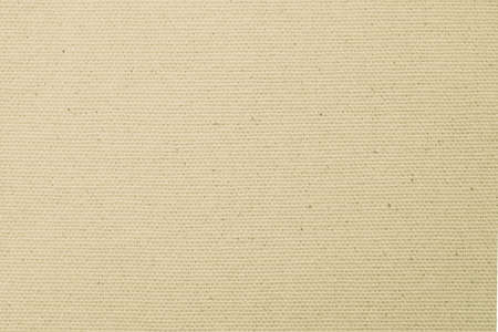 Hessian sackcloth woven texture pattern background in light yellow cream brown Zdjęcie Seryjne