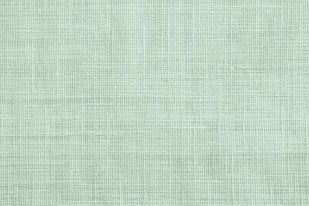 Jute hessian sackcloth canvas sack cloth woven texture pattern background in pastel light green color