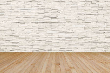 Limestone rock tile wall backdrop in light cream beige color with wooden floor in yellow brown Zdjęcie Seryjne