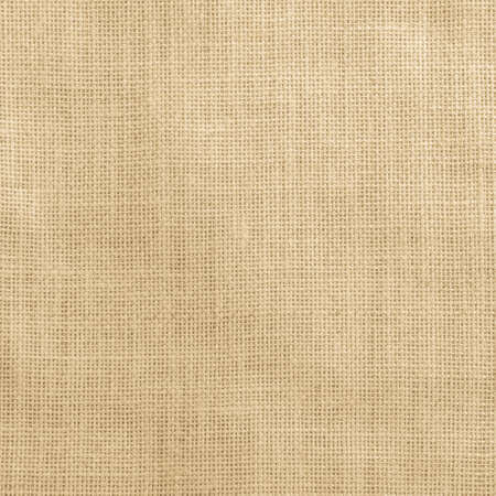 Jute fabric sackcloth burlap texture background yellow cream brown color