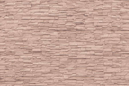 Rock stone brick tile wall aged texture detailed pattern background in cream red brown color