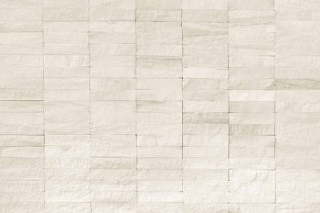Rock stone tile wall texture rough patterned background in white cream color Reklamní fotografie - 142030004