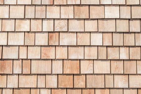 Shingle red cedar wooden shake wood siding row roof panel made of larch conifer tree Reklamní fotografie - 142030881