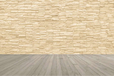 Limestone rock tile wall backdrop in yellow cream brown color tone with wooden floor in light sepia colour