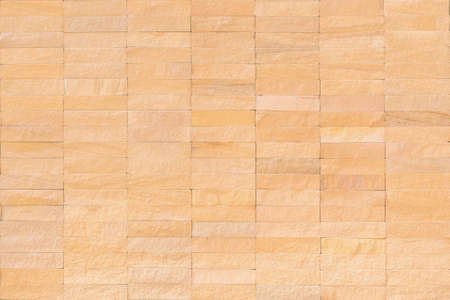 Rock tile wall texture background in natural cream brown beige