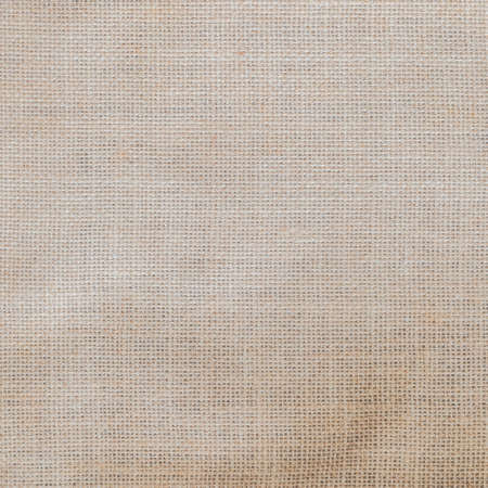 Hessian sack cloth texture canvas fabric pattern background in light cream beige brown color