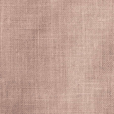Hessian sackcloth woven texture pattern background in light red cream beige brown color