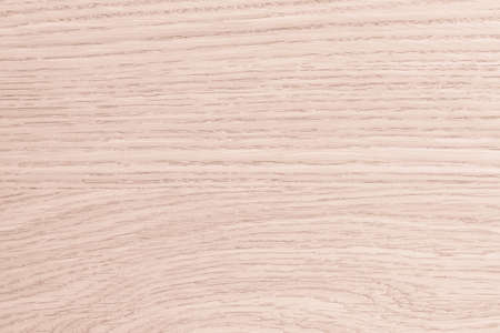 Wooden textured grainy detail backdrop in natural light red oak brown color