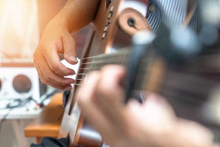 Electric guitar player or guitarlist playing live music show or rehearsal for stag performance or concert