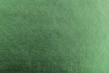 Green background metallic texture wrapping foil paper shiny metal backdrop for wall paper decoration element