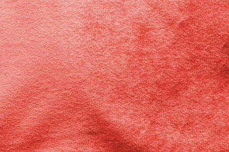 Red velvet background or velour flannel texture made of cotton or wool with soft fluffy velvety satin fabric cloth rose gold metallic color material    Banco de Imagens