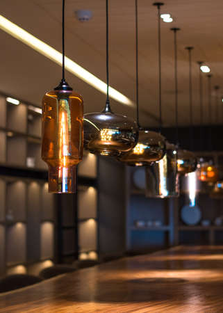 Lamp lighting with light bulbs hanging from ceiling (soft focus) for luxurious hotel and restaurant interior design decoration Stock fotó