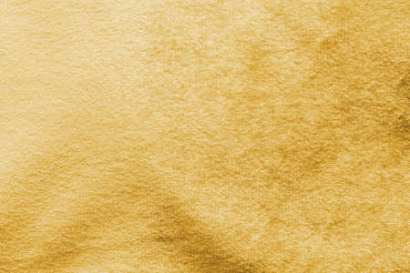 Gold velvet background or golden yellow velour flannel texture made of cotton or wool with soft fluffy velvety satin fabric cloth metallic color material Stok Fotoğraf