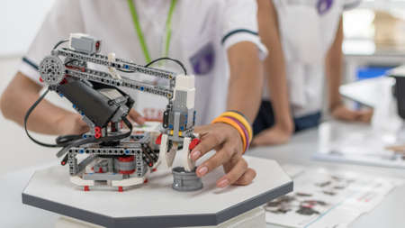 Robotic lab class with school students blur background in AI learning or group study workshop in science technology engineering classroom for STEM education Stock fotó