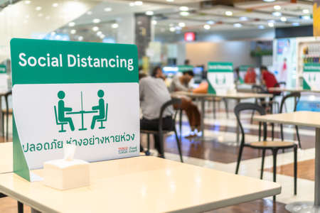 BANGKOK, THAILAND- June 28, 2020: Social distancing for COVID-19 disease pandemic prevention in Tesco Lotus food court dining table public area for keeping people distance