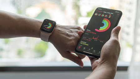 Bangkok, Thailand - September 11, 2020: Apple Activity on iphone sync with Apple watch displaying body moving calories and execise time for fitness and health care