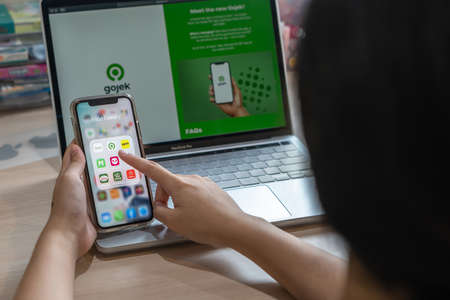 Bangkok, Thailand - September 7, 2020: Gojek app on mobile phone among other food delivery services, Grab, Get, Lineman, Foodpanda, Pizza company, MK for digital lifestyle