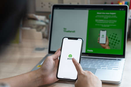 Bangkok, Thailand - September 7, 2020: Gojek app on mobile phone with services GoRide, GoSend, GoShop, and GoFood by Indonesian unicorn company operating business in Southeast Asia Sajtókép