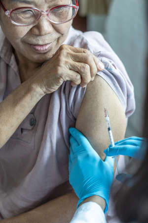 Vaccine shot for elderly people vaccination, medical immunization for aging woman or older patient, geriatric treatment from disease such as coronavirus, covid-19, Influenza , pneumococcal, or hepatitis B