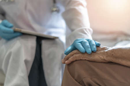 Parkinson's disease patient, Arthritis hand and knee pain or mental health care concept with geriatric doctor consulting examining elderly senior aged adult in medical exam clinic or hospital