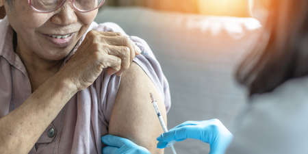 Vaccine shot for elderly vaccination, medical immunization for aging senior woman, older patient, geriatric treatment from disease such as coronavirus, covid-19, Influenza, pneumococcal or hepatitis B