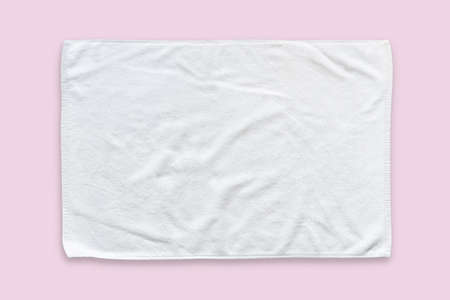 White cotton towel mock up template fabric wiper isolated on pastel pink background with clipping path, flat lay top view