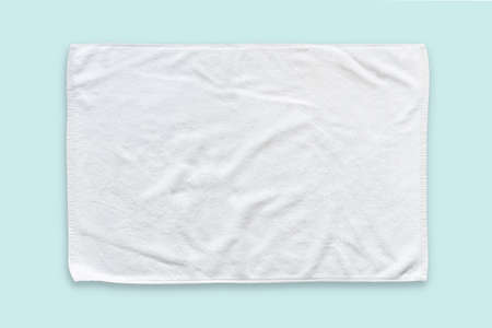 White cotton towel mock up template fabric wiper isolated on blue