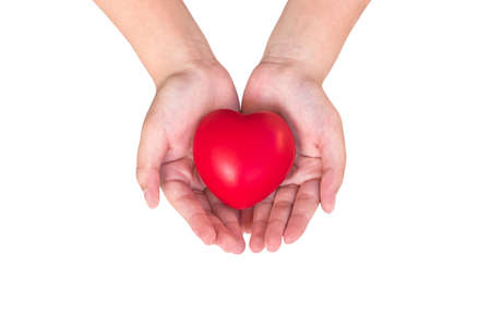 Heart in hands of young girl kid isolated on white 版權商用圖片