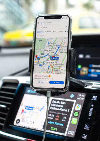 BANGKOK, THAILAND-27 October, 2020: Google Maps app with Apple CarPlay on car screen dashboard and iPhone, smart UI mobile application for travel navigation and vehicle transportation safety Standard-Bild - 159072191