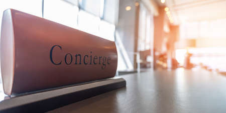 Concierge service counter of hotel, restaurant or apartment's front desk in luxury reception hall with staff working for serving tourist guest or check-in customers Standard-Bild