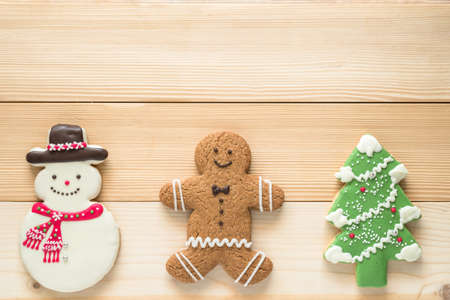 Christmas cookies, snowman, X'mas tree, gingerbread flat lay on wooden cutting board background top view for Xmas party holiday food design decoration backdrop with copy space Standard-Bild - 159131075