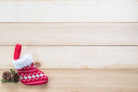 Christmas background with red baby sock xmas gift decoration on white pine wood table for boxing day, winter seasonal holiday and new year celebration 版權商用圖片