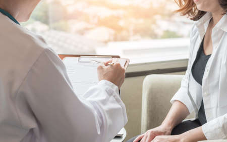 Breast cancer awareness in menopause woman who consulting with doctor diagnostic examining on obstetric - gynaecological female patient illnes and health in medical clinic Standard-Bild - 159127301