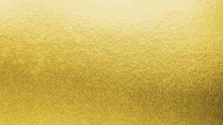 Gold background metallic golden foil texture or shinny wrapping paper bright yellow wall paper for design decoration element