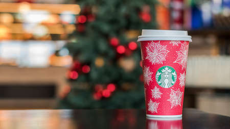 BANGKOK, THAILAND - November 17, 2016: Starbucks coffee Christmas red cup drink beverage brand originated in USA celebrate xmas and new year anniversary with special design cup in red